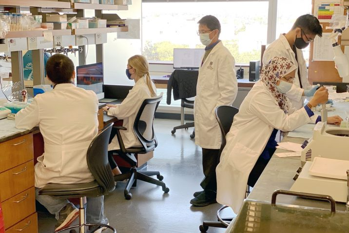 People standing in a research lab