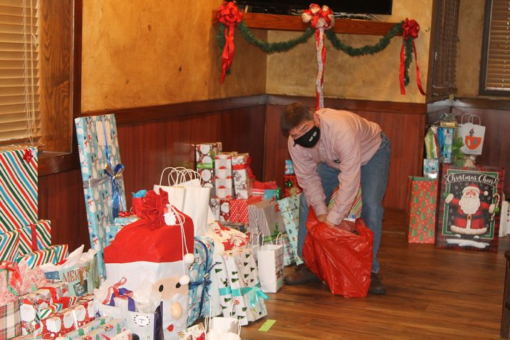 Man putting presents in a bag