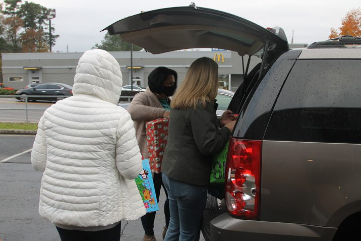 Women putting presents in trunk