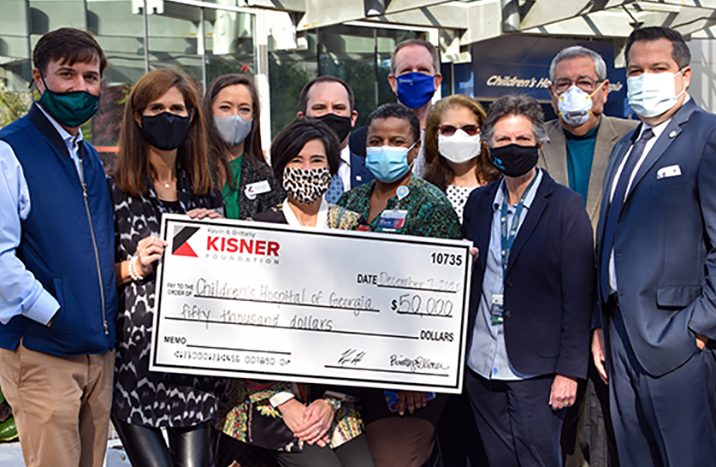 A group of people posing with a large check.