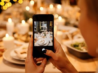 cellphone taking photo of holiday table