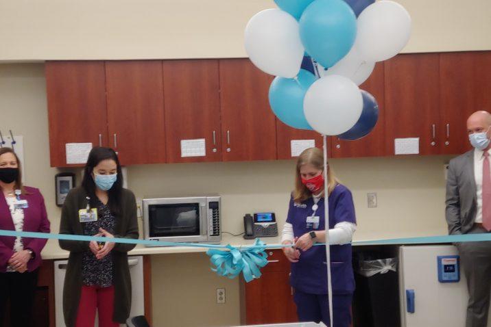 two women cut ribbon