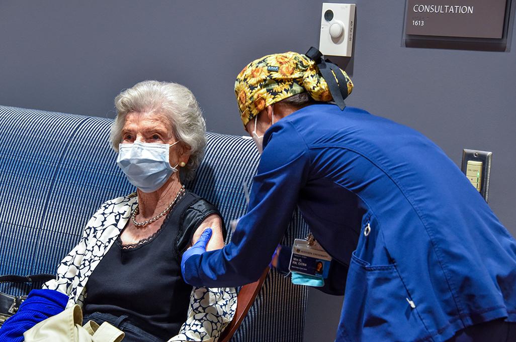 Nurse giving a woman a shot