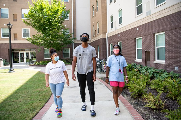 Three students walking