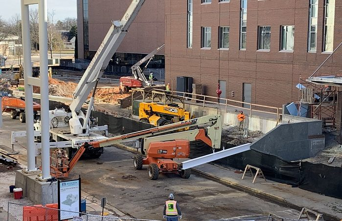 steel beam hovers over ground