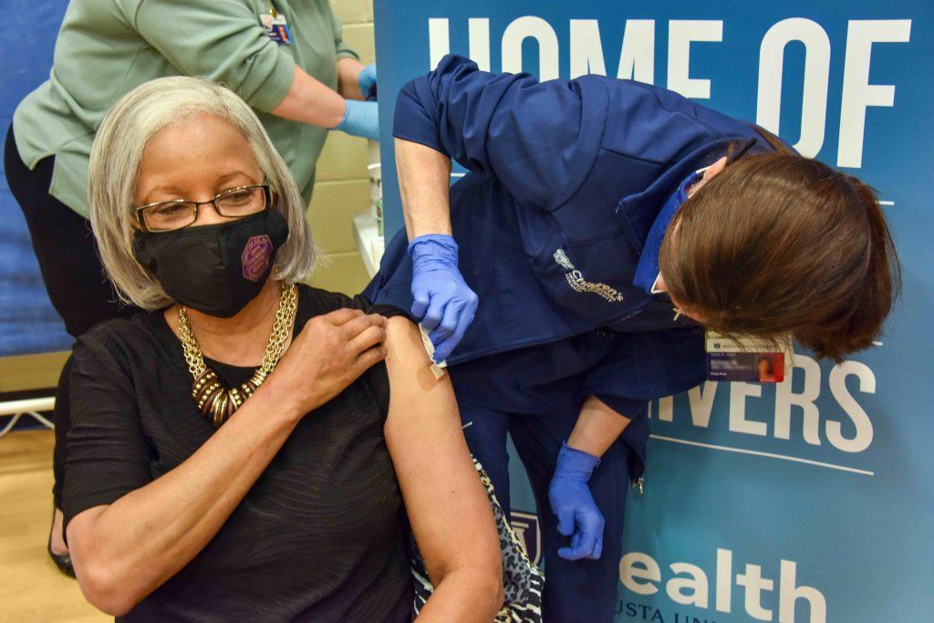 woman puts bandage on woman
