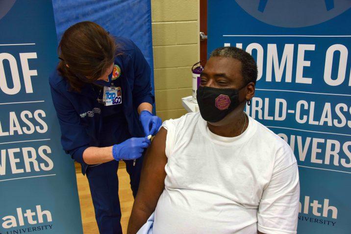 woman places bandage on man