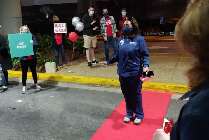 woman walks red carpet