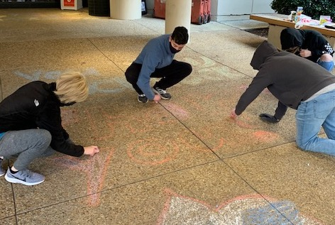 boys drawing with chalk