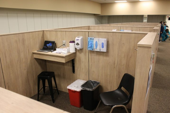 chairs and medical equipment in cubicle