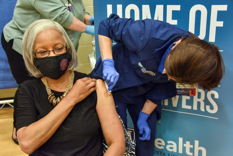 Woman getting vaccine