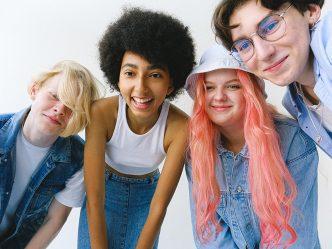 Four teens looking at camera