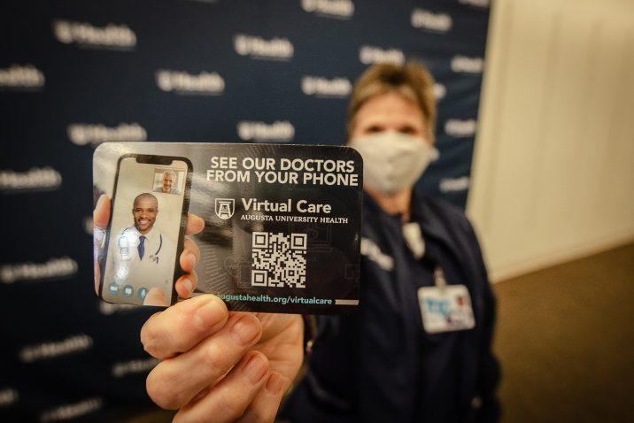 female nurse holds card