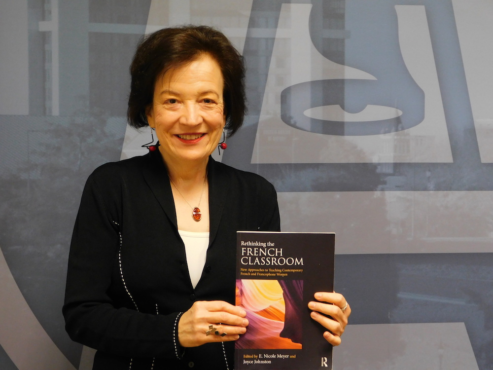 Professor with her book