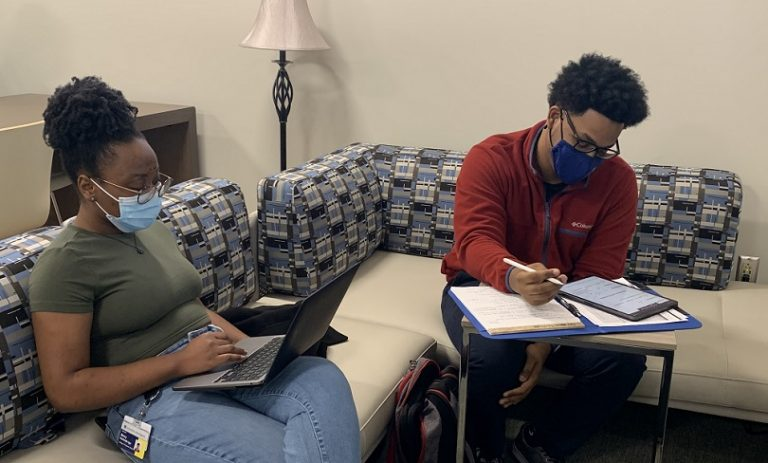 two adult students studying