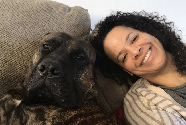 dog and woman on couch