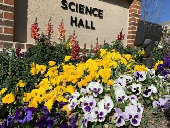multicolored flowers and Science Hall sign