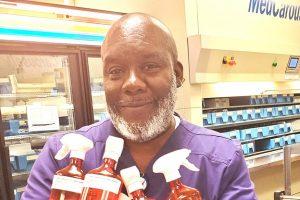 Man holding bottles