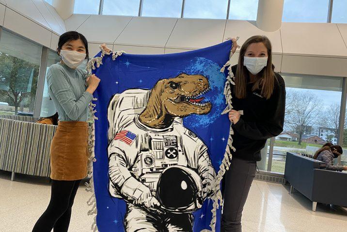 Women holding a blanket