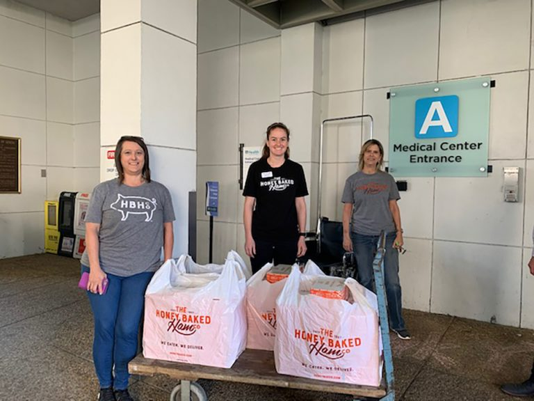 three women with bags of food