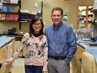 Drs. Xiaochun Long (on left) and Joseph Miano stand in their lab together