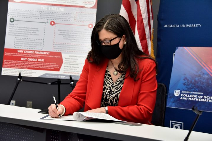woman signs document