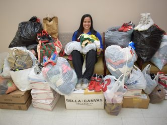 Woman surrounded by bags of clothes