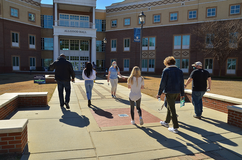 students and families taking a tour