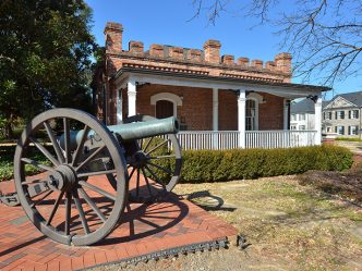 old building with cannon