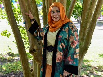 Woman in hijab under tree