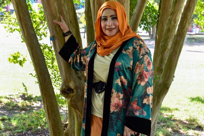 Woman in hijab under tree