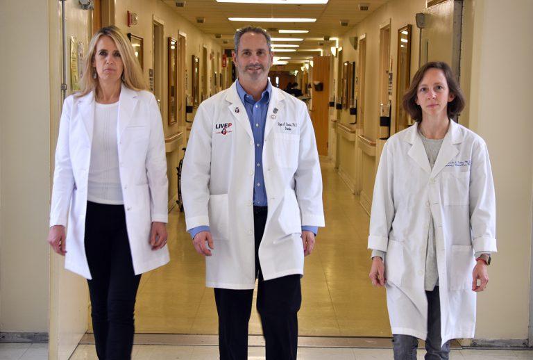Three doctors walking