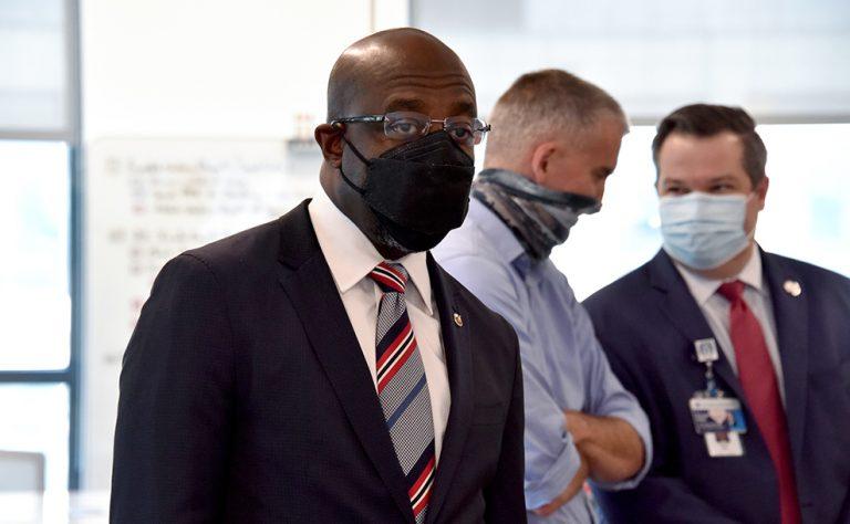 Three men in masks