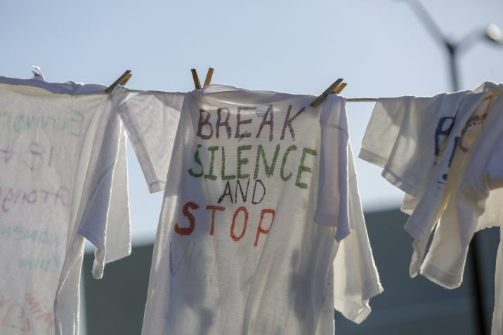 shirt on clothesline says 'Break Silence and Stop Violence'
