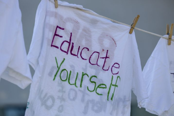 shirt says 'Educate yourself'