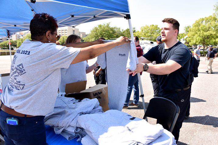 Two men holding T-shirt