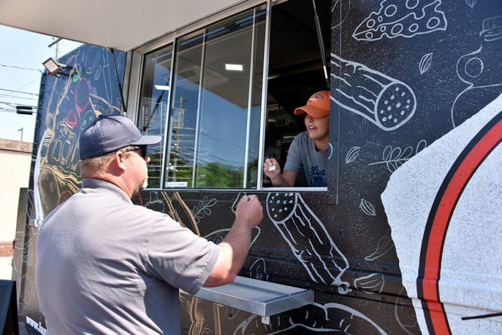 Man ordering at food truck window