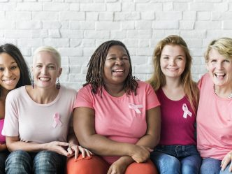 women wearing pink ribbons