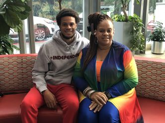 Young man and mom seated on couch