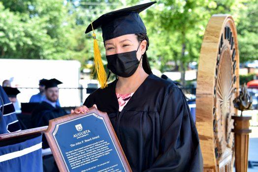 Graduate with award