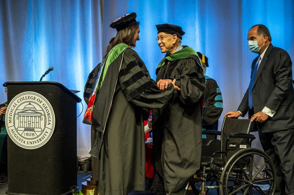 graduate congratulated on stage