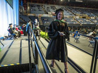 graduate walking off stage