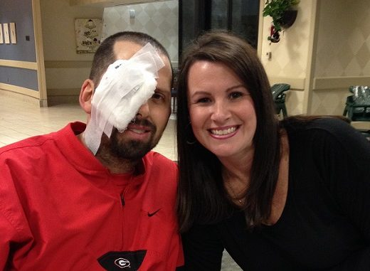 patient with eye bandage and wife