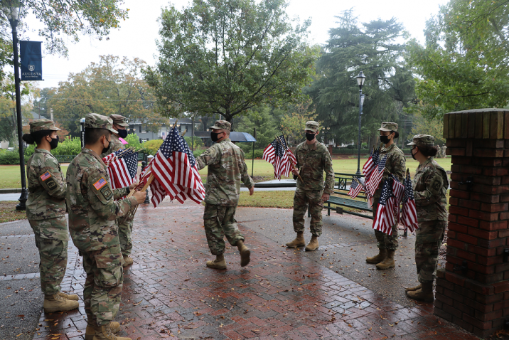 Members of military with flag
