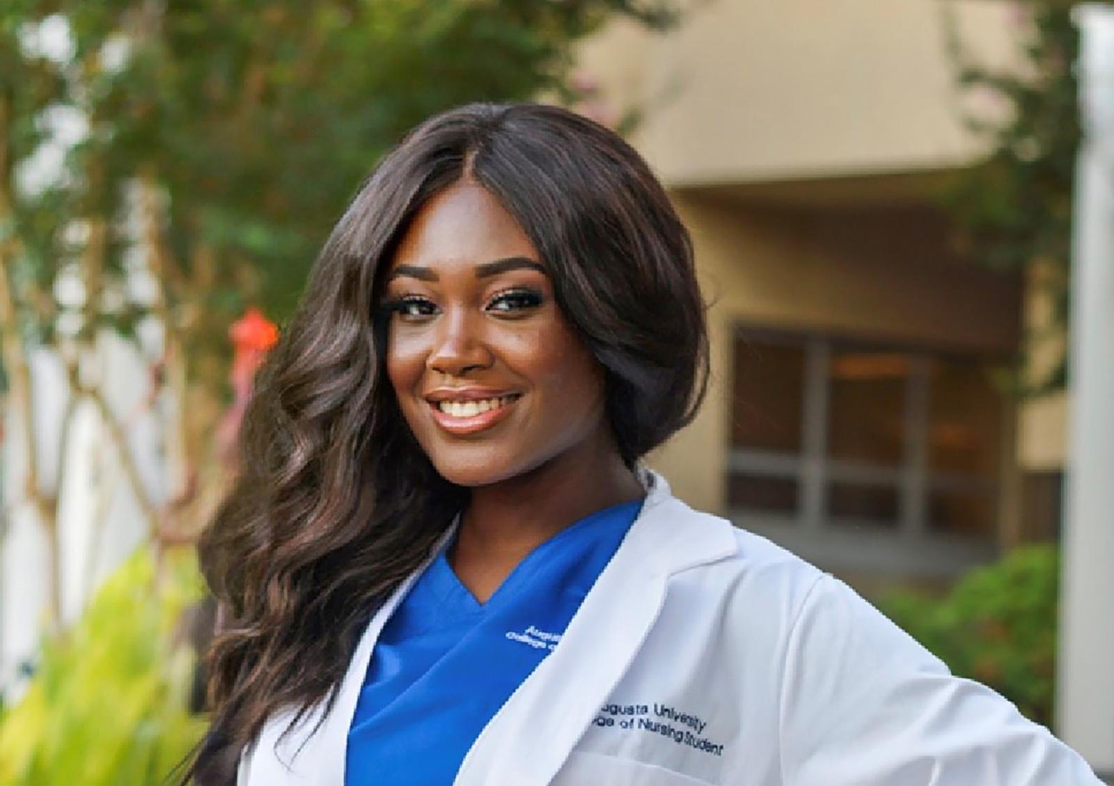 Nursing student in white coat