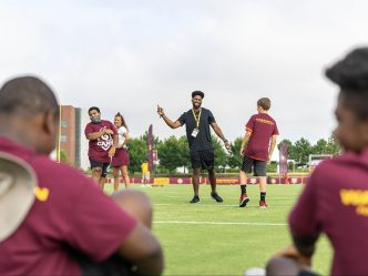 Man coaching kids