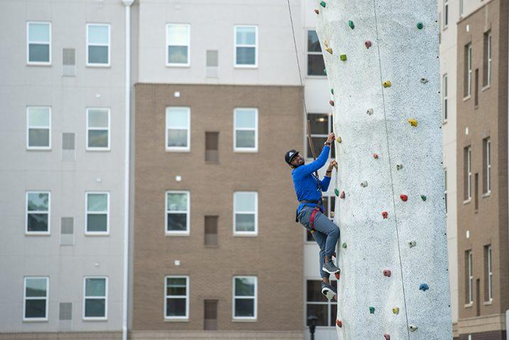 Person climbing rock wall