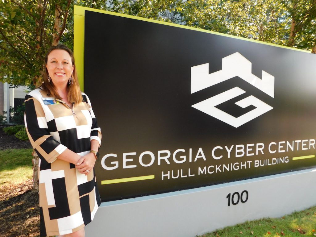 Woman standing by Georgia Cyber Center sign
