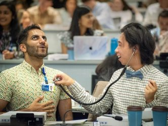 students use stethoscope on each other