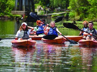 People in kayaks on river